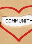 brown paper ripped to reveal the word community, red heart line drawn around community